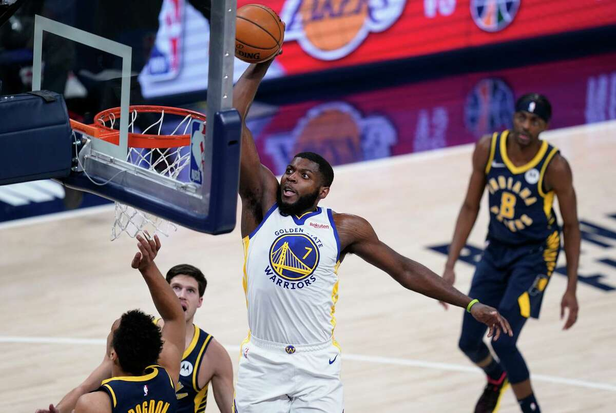Warriors forward Eric Paschall dunks against the Indiana Pacers in a home game on Feb. 24.