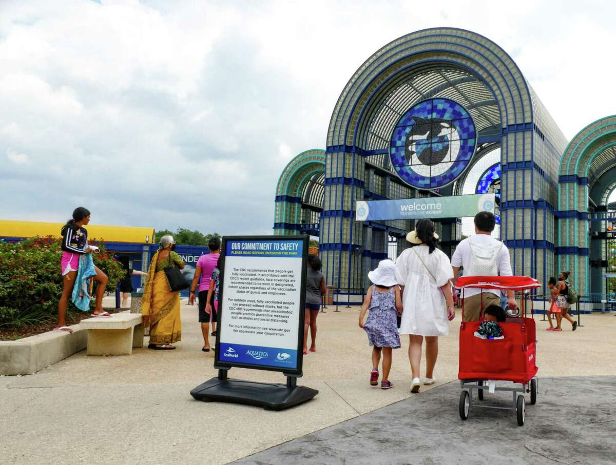 A sign placed by the front entrance of SeaWorld San Antonio informs guests about masking policies on Tuesday, Aug. 3, 2021.