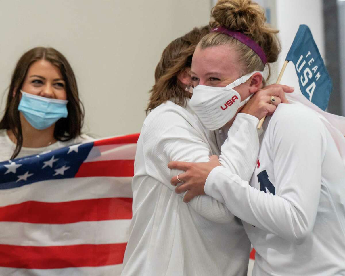 Emma White hugs her mom, Chris White, at the Albany International Airport on Wednesday, Aug. 4, 2021, after winning a bronze in the cycling team pursuit in the Tokyo Olympics. (Jim Franco/Special to the Times Union)