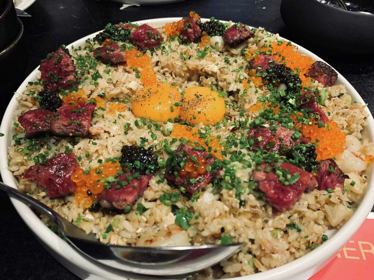 Wagyu, uni, caviar, black truffle XO sauce and more are in this crab fried rice, which Lily has taken off the menu.