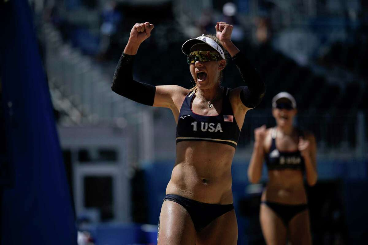 April Ross, left, of the United States, and teammate Alix Klineman celebrate during a women's beach volleyball semifinal match against Switzerland at the 2020 Summer Olympics, Thursday, Aug. 5, 2021, in Tokyo, Japan. (AP Photo/Felipe Dana)