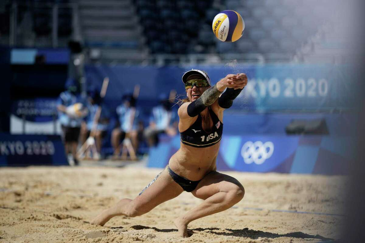 April Ross, of the United States, dives for the ball during a women's beach volleyball semifinal match against Switzerland at the 2020 Summer Olympics, Thursday, Aug. 5, 2021, in Tokyo, Japan. (AP Photo/Felipe Dana)