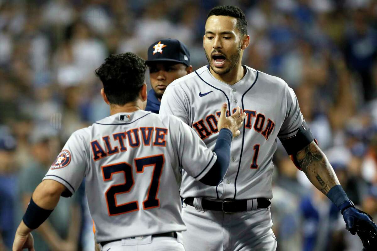 Houston Astros' Carlos Correa, right, celebrates his solo home run with Jose Altuve against the Los Angeles Dodgers during the eighth inning of a baseball game in Los Angeles, Wednesday, Aug. 4, 2021. (AP Photo/Alex Gallardo)