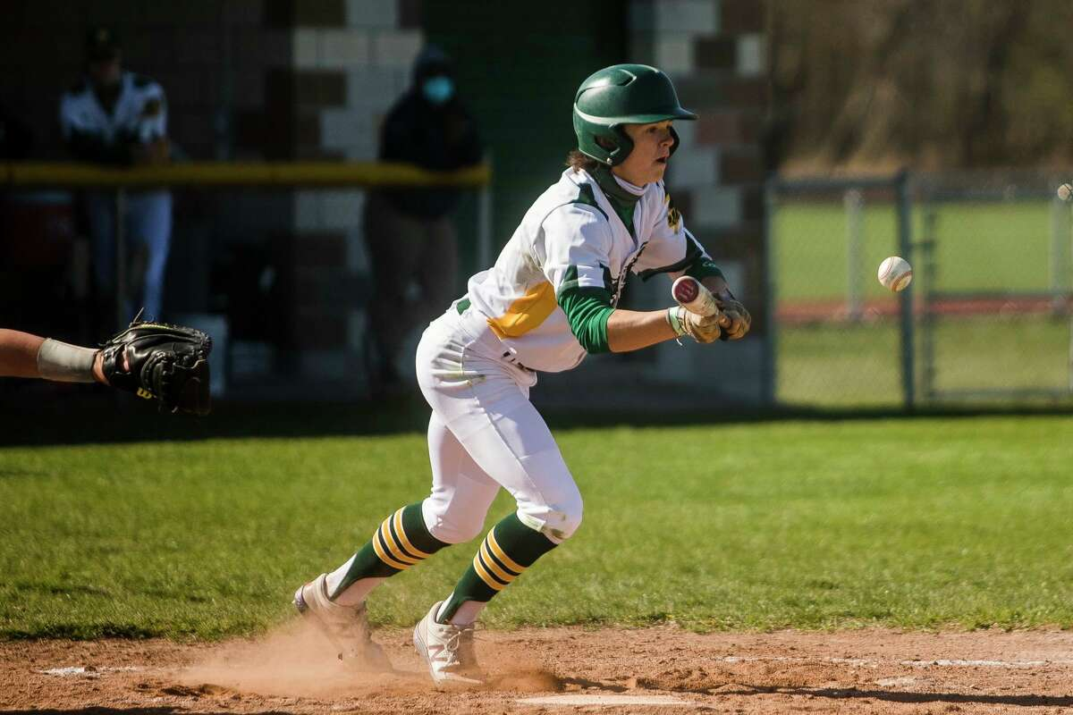 Dow High's Nolan Sanders lays down a bunt during an April 22, 2021 game against Flint Powers. (Daily News file photo)