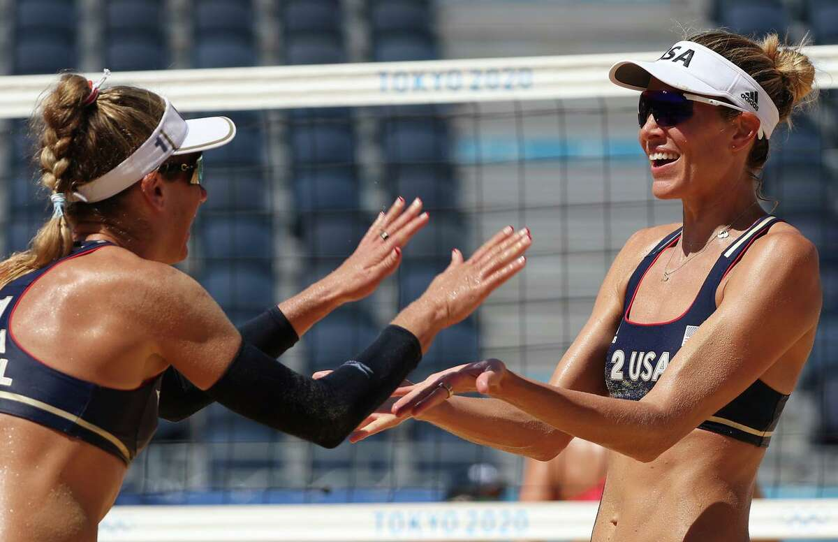 April Ross and Alix Klineman of the U.S. celebrate after defeating Switzerland in straight sets during the beach volleyball semifinals. They will take on Australia in the finals Friday.