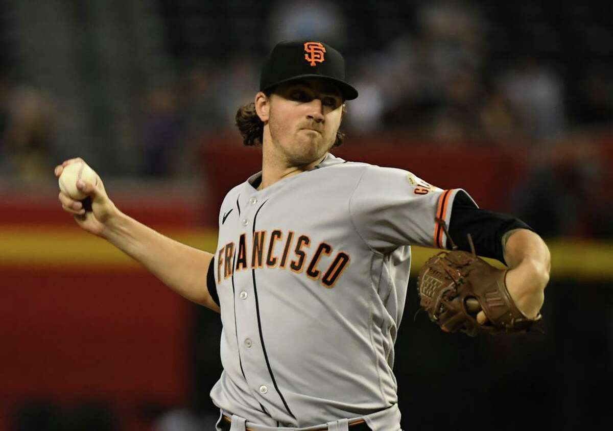 PHOENIX, ARIZONA - AUGUST 04: Kevin Gausman #34 of the San Francisco Giants pitches in the first inning against the Arizona Diamondbacks at Chase Field on August 04, 2021 in Phoenix, Arizona. (Photo by Norm Hall/Getty Images)