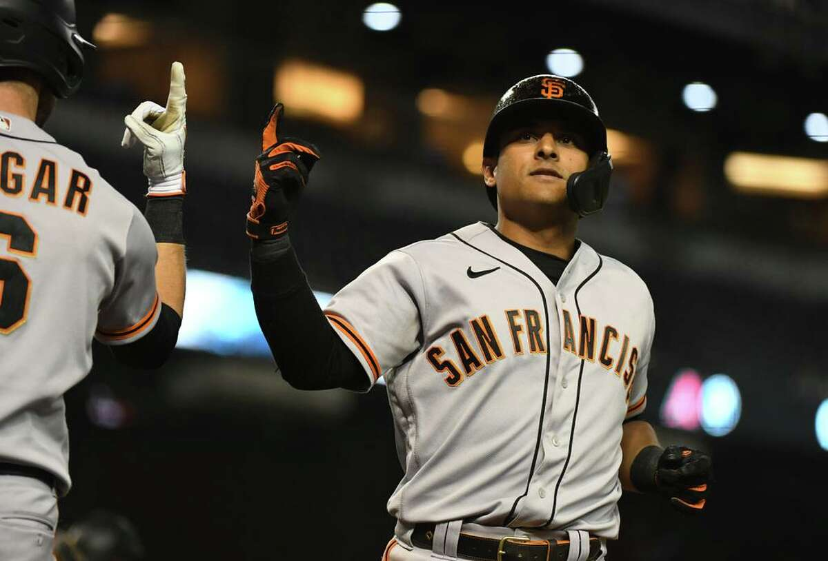 PHOENIX, ARIZONA - AUGUST 04: Donovan Solano #7 of the San Francisco Giants celebrates with Steven Duggar #6 after hitting a solo home run off of Zac Gallen of the Arizona Diamondbacks during the fourth inning at Chase Field on August 04, 2021 in Phoenix, Arizona. (Photo by Norm Hall/Getty Images)