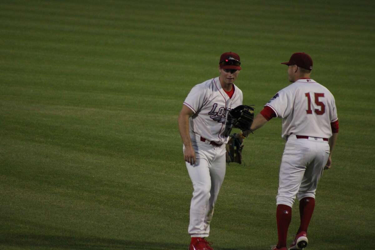 Loons center fielder Jonny DeLuca (left) and left fielder Ryan Ward (right) celebrate a recorded out against Fort Wayne on Aug. 4 at Dow Diamond.