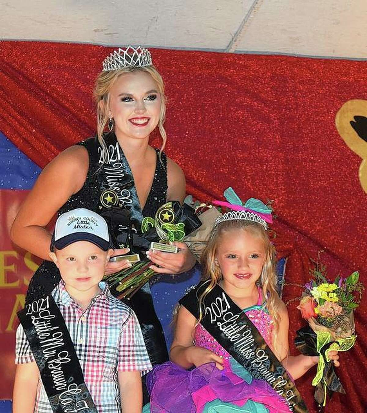 Brown County Fair's 2021 royalty - Miss Brown County Isabelle Koch, Little Mister Henry Barfield and Little Miss McKenna Ormond were crowned Tuesday during a pageant on the fair's opening night.