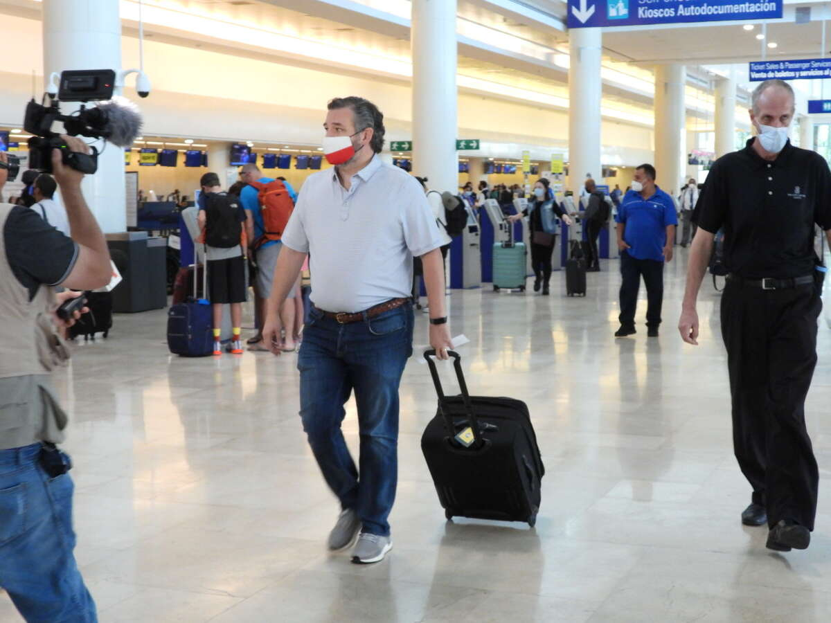 U.S. Sen. Ted Cruz checks in for a flight at Cancun International Airport after a backlash over his Mexican family vacation as his home state of Texas endured a deadly winter storm on Feb. 18, 2021.