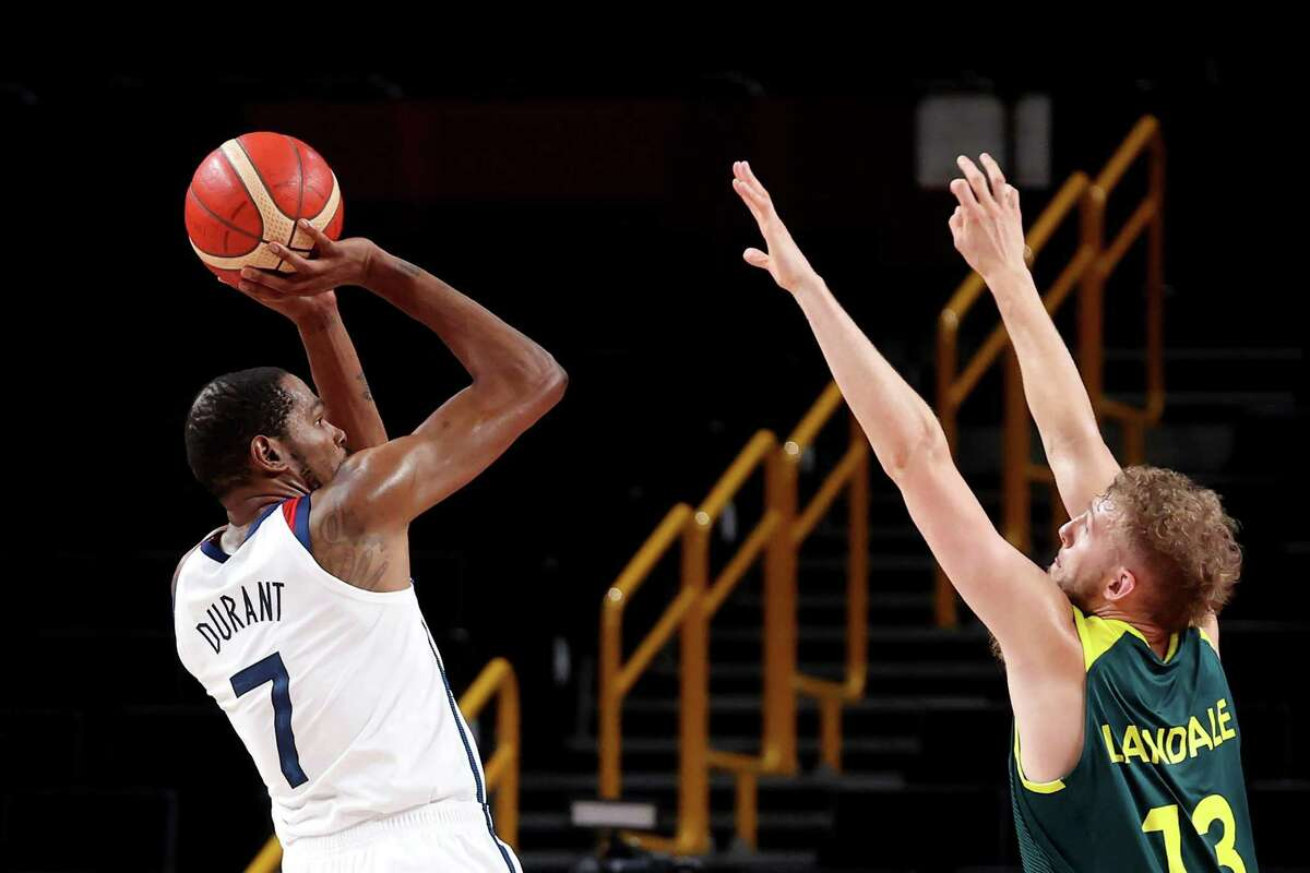 Kevin Durant finished with 23 points and led a 20-0 run by the U.S. in the second and third periods to beat Australia and reach the gold medal game.