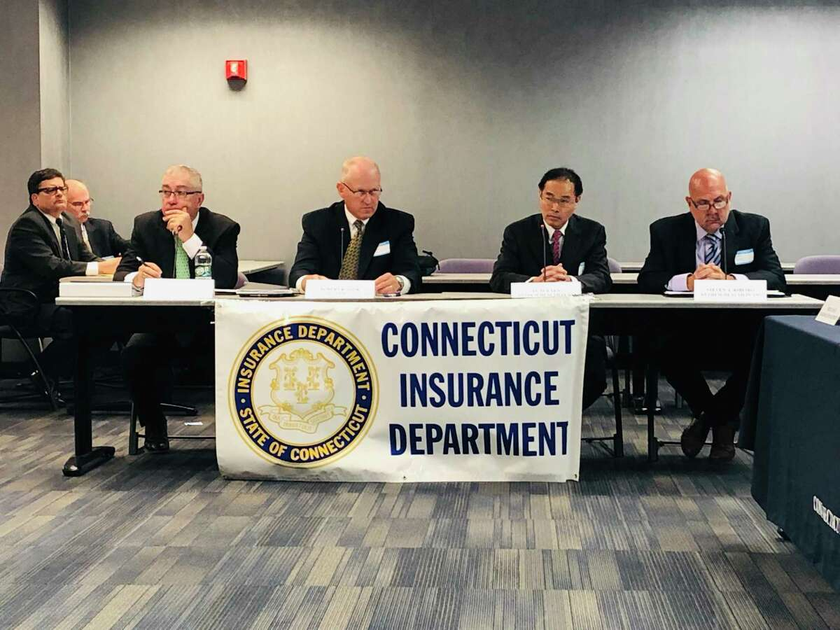 Insurance officials attend a public hearing on proposed rate hikes in 2019.
