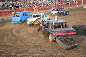 Fairgoers enjoyed Chase's Racing Pigs, rides, animal exhibits and most notably, the demolition derby on Wednesday at the 2021 Huron Community Fair.
