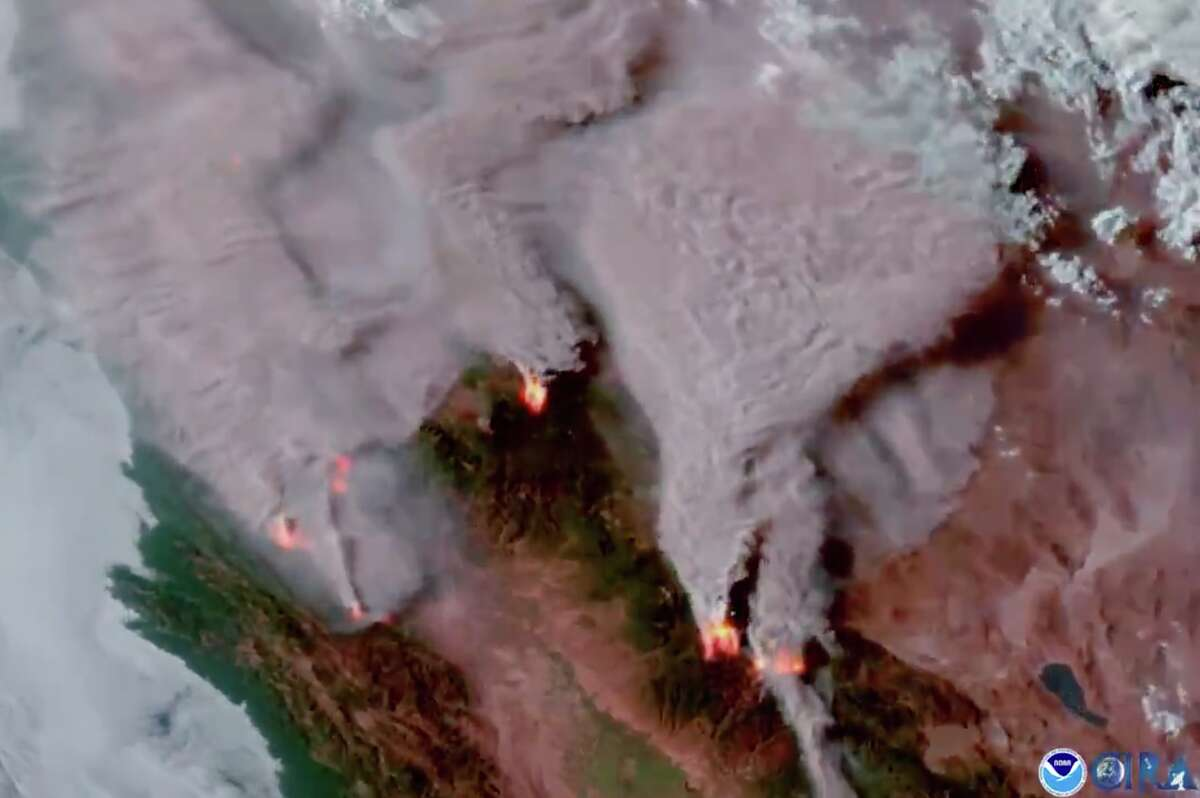 NASA shared satellite imagery on Twitter on Aug. 4, 2021, showing massive smoke plumes over California from multiple wildfires.