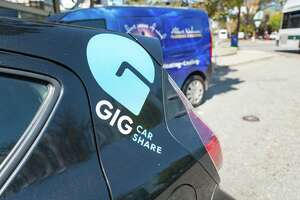 Close-up of logo for Gig Car Share service on the back of a rentable car in Berkeley, California.