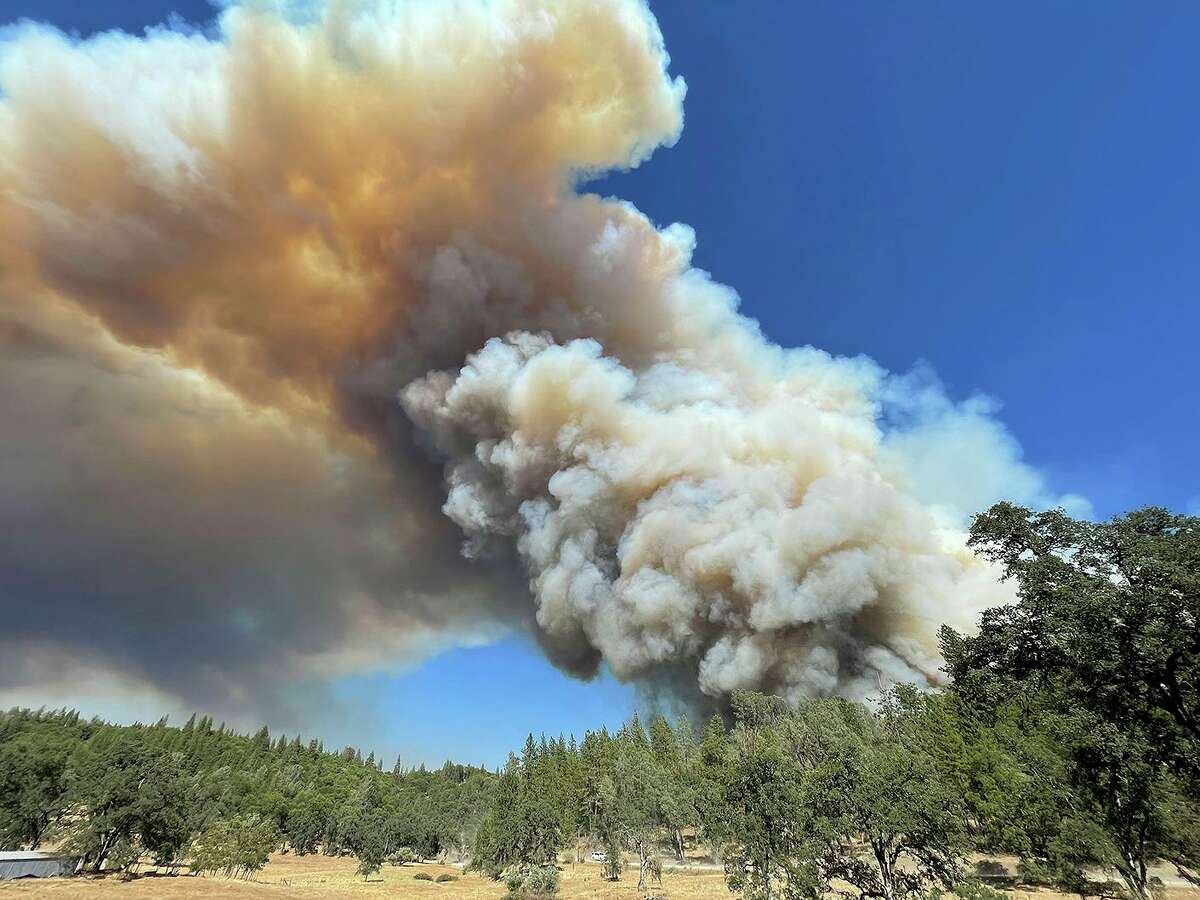 A large plume from the River Fire fills the air with smoke near the Bear River Campground, Wednesday, Aug. 4, 2021 in Colfax, Calif. Smoke drifting from the River Fire and two others was expected to create hazy skies across parts of the Bay Area on Thursday and Friday.