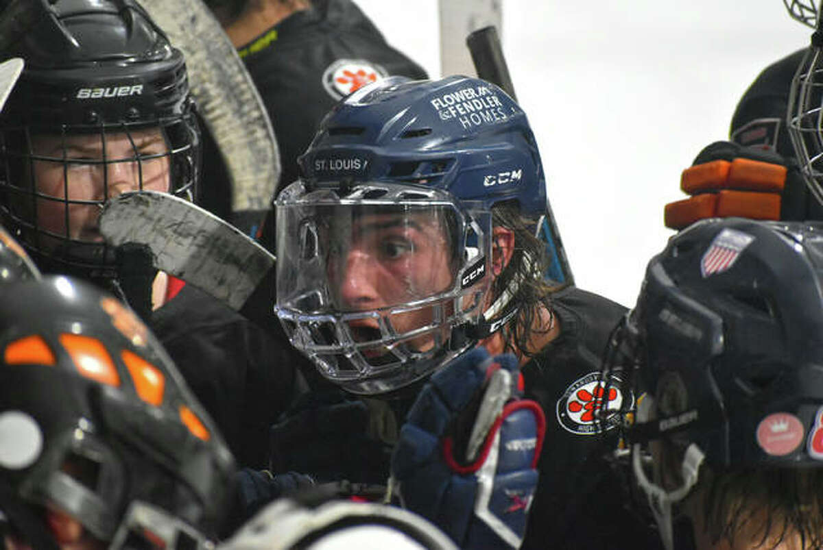 Edwardsville captain Cam Gillen fires up his teammates during the intermission of Game 2 against the Granite City Warriors in the MVCHA championship series at the East Alton Ice Arena.