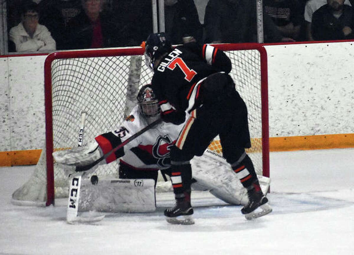 Edwardsville captain Cam Gillen scores the game-winning goal in a shootout against the Granite City Warriors to clinch the MVCHA championship.