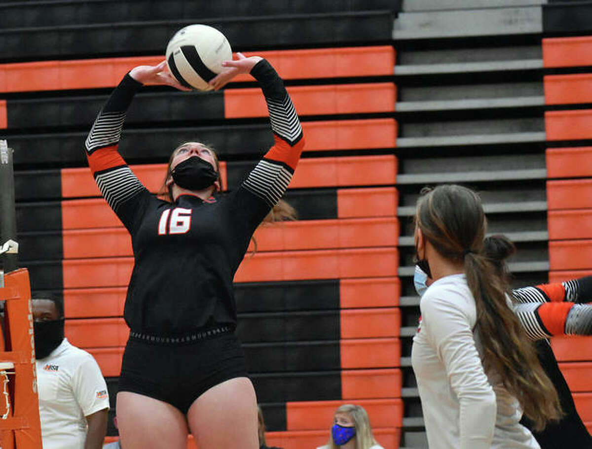 Edwardsville's Lexie Griffin sets up a pass for a teammate during the first game against East St. Louis in Edwardsville.