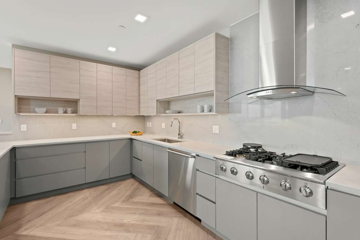 The penthouse's kitchenis finished with Silestone countertops and has a gas stove.