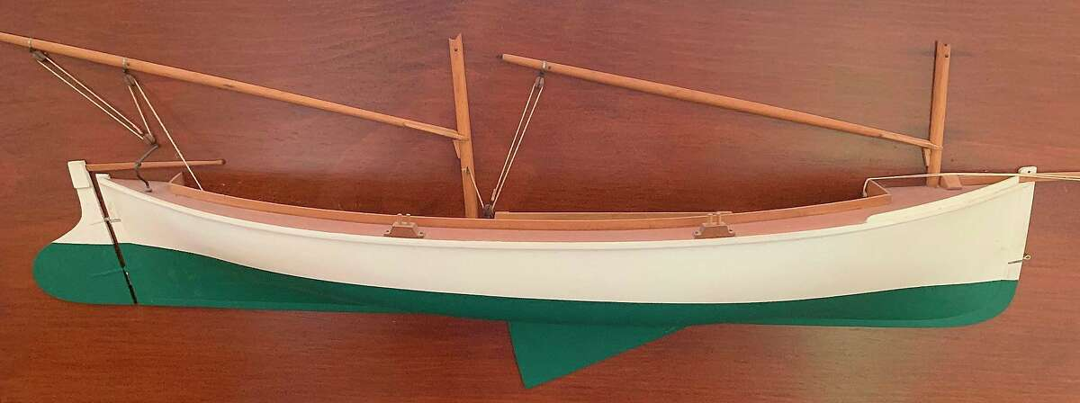 This model of a Mackinaw boat shows the centerboard protruding from the bottom of the vessel. A centerboard is aretractable feature that gives a sailing vessel purchase in the water and allows it to be pushed ashore in areas where there is no harbor. (Robert McGreevy/Courtesy photo)