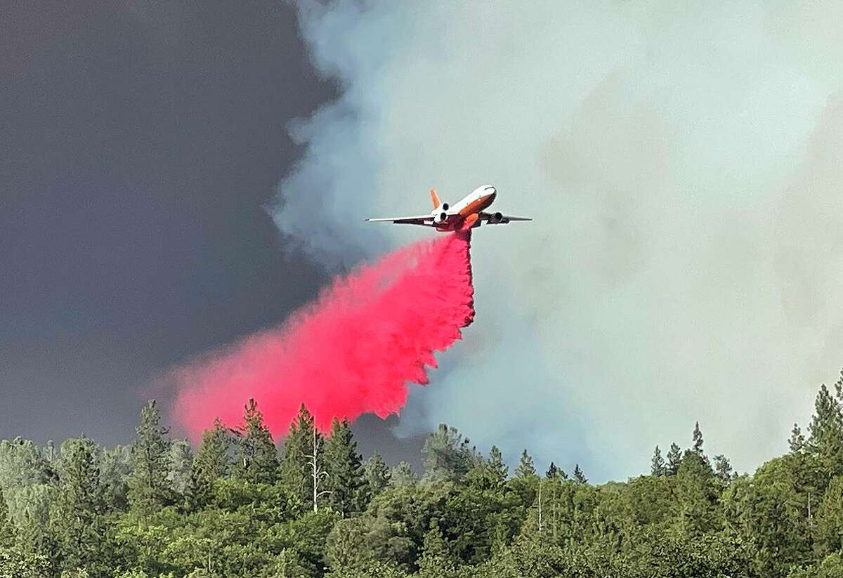 An air tanker makes a retardant drop Wednesday over a flank of the River Fire near Taylor Crossing Road in Nevada County.