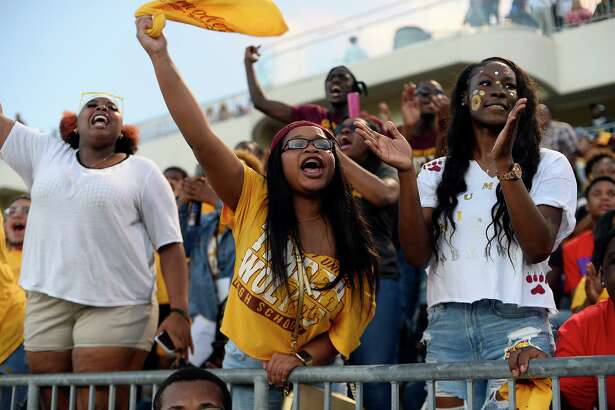 """Beaumont United fans cheer during the """"Alumni Bowl"""" between Beaumont United and West Brook at the Beaumont ISD Memorial Stadium on Friday night. Photo taken Friday 10/5/18 Ryan Pelham/The Enterprise"""