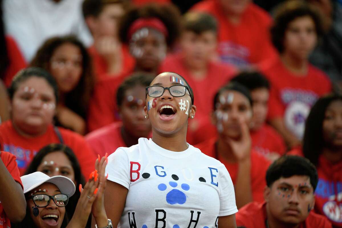"""West Brook fans cheer before the """"Alumni Bowl"""" between Beaumont United and West Brook at the Beaumont ISD Memorial Stadium on Friday night. Photo taken Friday 10/5/18 Ryan Pelham/The Enterprise"""