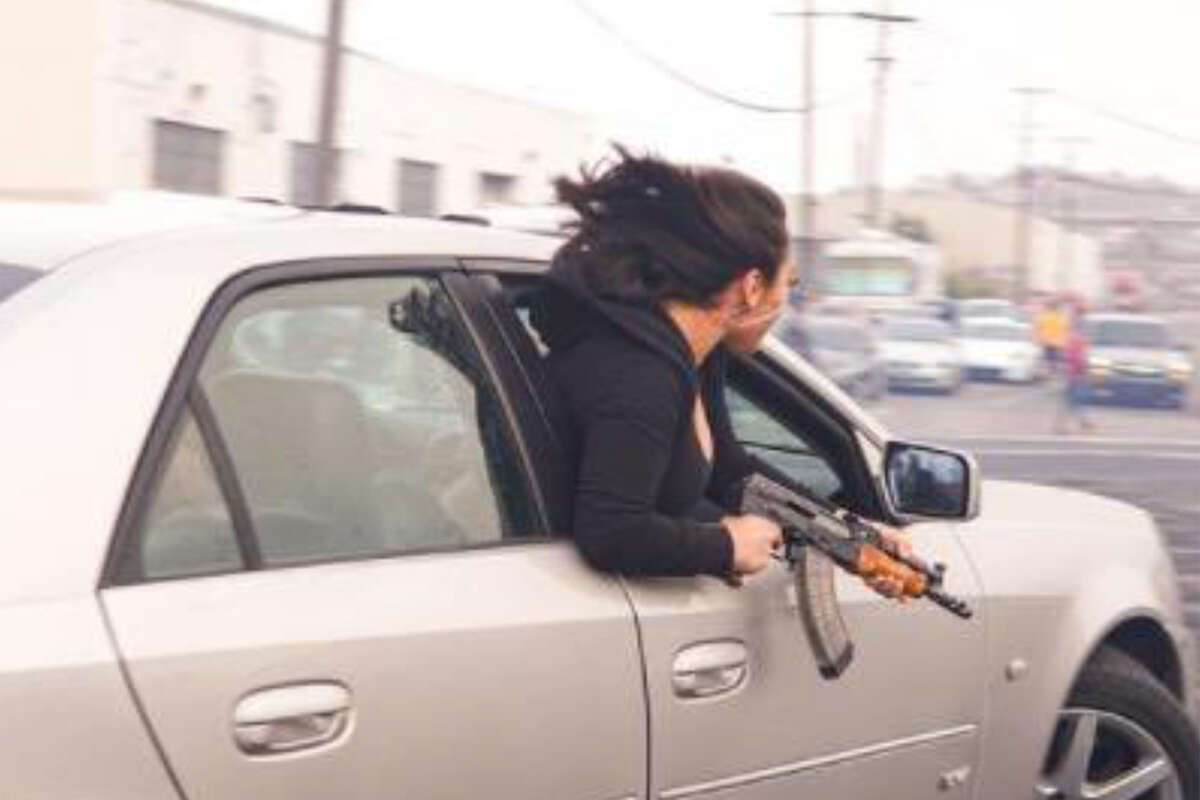 While speeding at Barneveld and McKinnon avenues in San Francisco, a passenger leaned out of a Cadillac holding an AK-47 on July 11, 2021, SFPD said