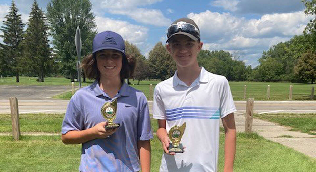Colten Lower (left) and Logan Gehoski pose with their trophies after finishing first and second, respectively, in the First Flight of the Midland Junior Golf City Championships 12-14 age division on Monday, Aug. 2, 2021.