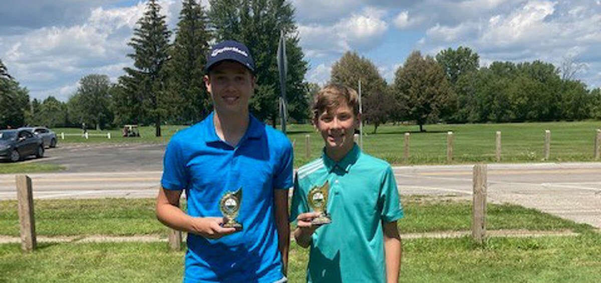 Garrett Nagley (right) and Matthew Wolohan pose with their trophies after finishing first and second, respectively, in the Second Flight of the Midland Junior Golf City Championships 12-14 age division on Monday, Aug. 2, 2021.
