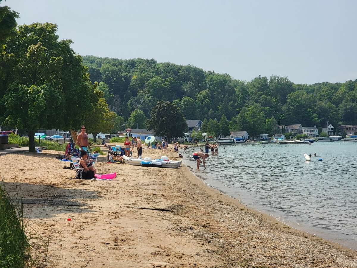 Beaulah Beach at Crystal Lake in Benzie County is a popular spot for recreating, such as on this day in late July. E.coli levels for Beulah Beach were reported on Aug. 5 to be over 1,500 parts per 100 ml, and the Benzie Leelanau District Health Department is advising no bodily contact at this time.