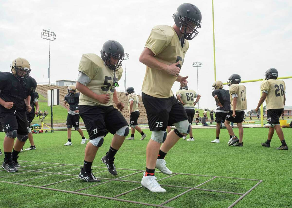 Andrews players run conditioning drills 08/05/2021 after practice at the Mustang Bowl. Tim Fischer/Reporter-Telegram
