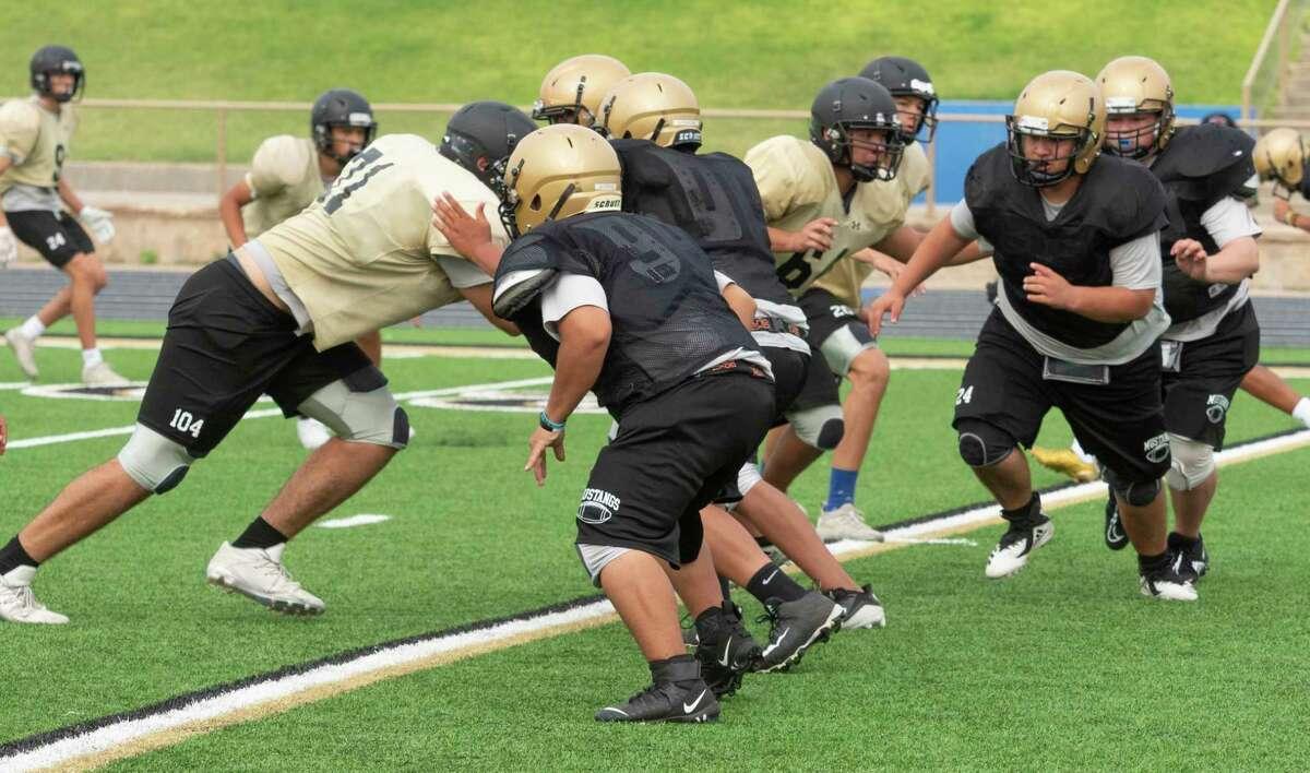 Andrews players run drills 08/05/2021 during practice at Andrews football field. Tim Fischer/Reporter-Telegram