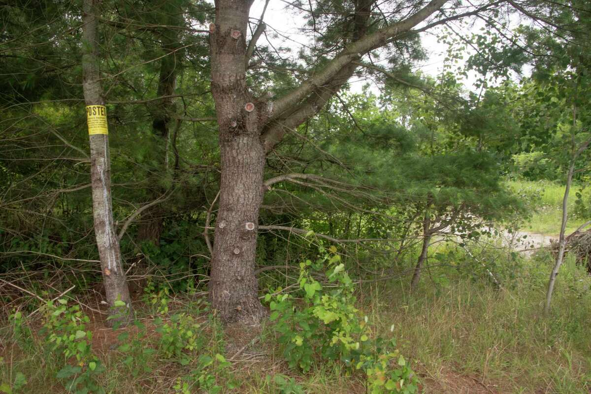 Private property signs are seen an an entrance to a road leading into the sand pit near former White Oaks Camp where a party was held July 30 in Nassau, N.Y.