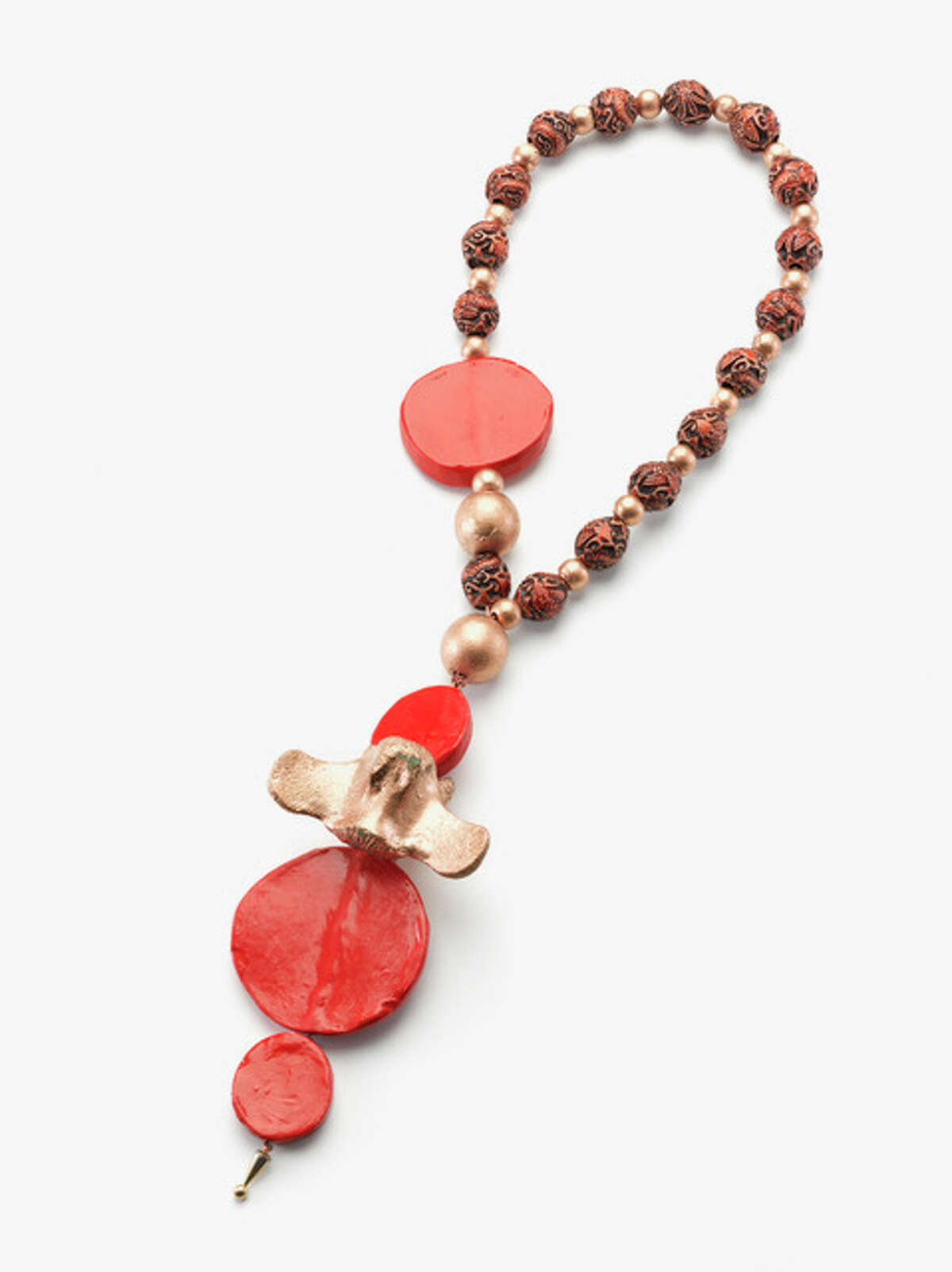 """This """"Sculpture in the form of a Necklace"""" combines oxtail bones with elements of Glyphs which Riley fabricated in ceramics during her Oxbow artist residency in Michigan a few years ago."""