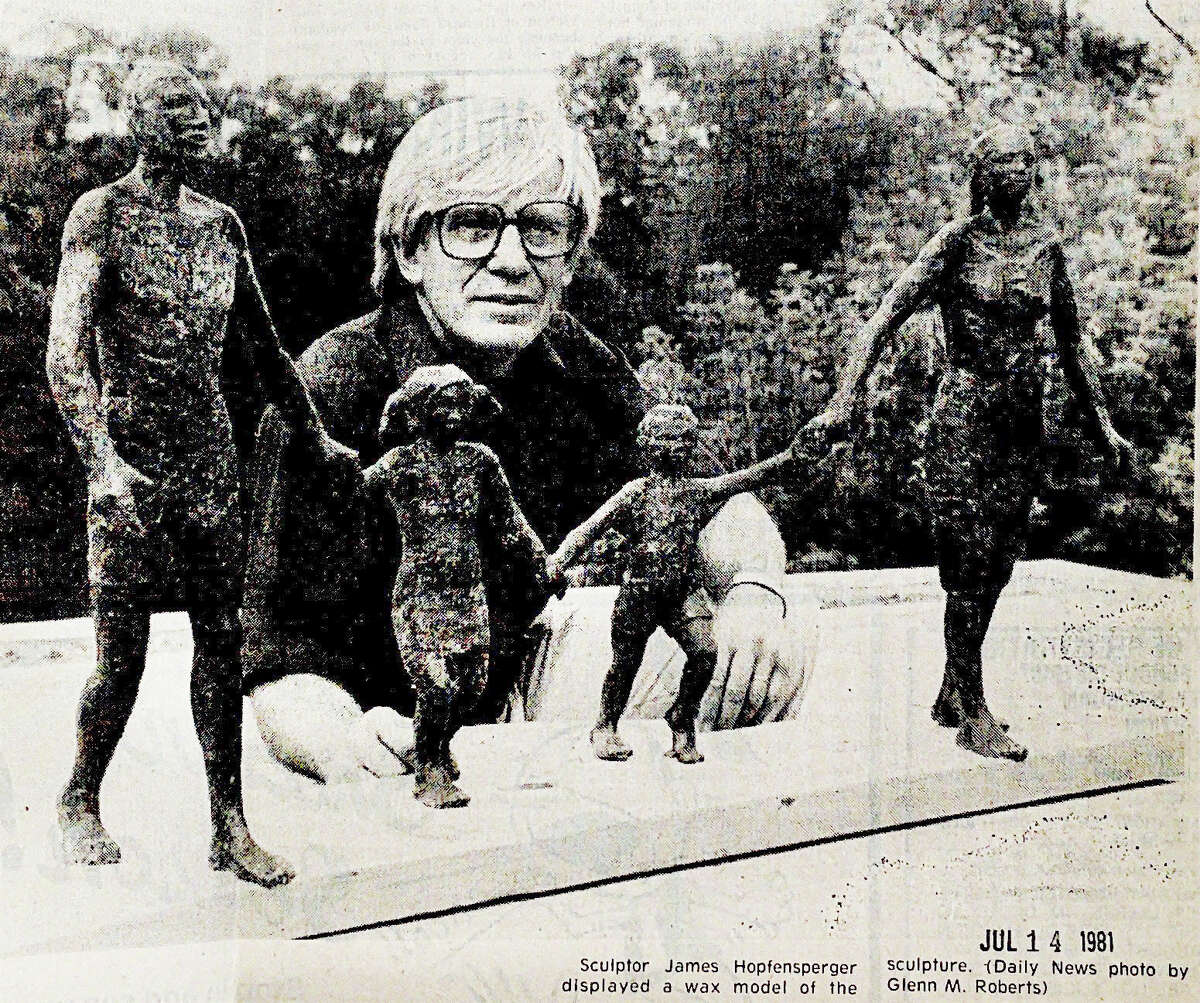 """A photo in the Midland Daily News from July 14, 1981 shows sculptor James Hopfensperger with a prototype of """"The Family,"""" a sculpture located in Chippewassee Park. (Daily News file)"""