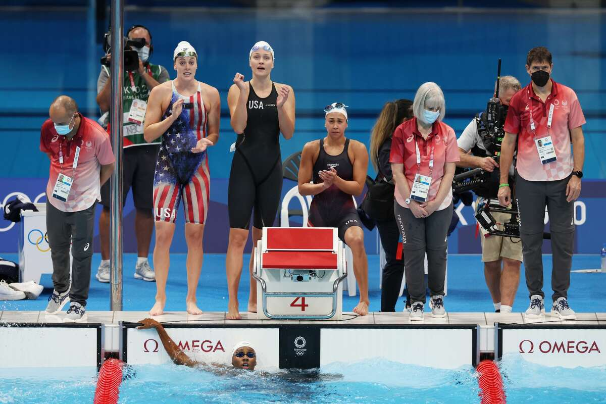 TOKYO, JAPAN - JULY 24: Olivia Smoliga, Catie Deloof, Allison Schmitt and Natalie Hinds of Team United States celebrate after finishing second in heat one of the Women's 4 x 100m Freestyle Relay on day one of the Tokyo 2020 Olympic Games at Tokyo Aquatics Centre on July 24, 2021 in Tokyo, Japan. (Photo by Tom Pennington/Getty Images)
