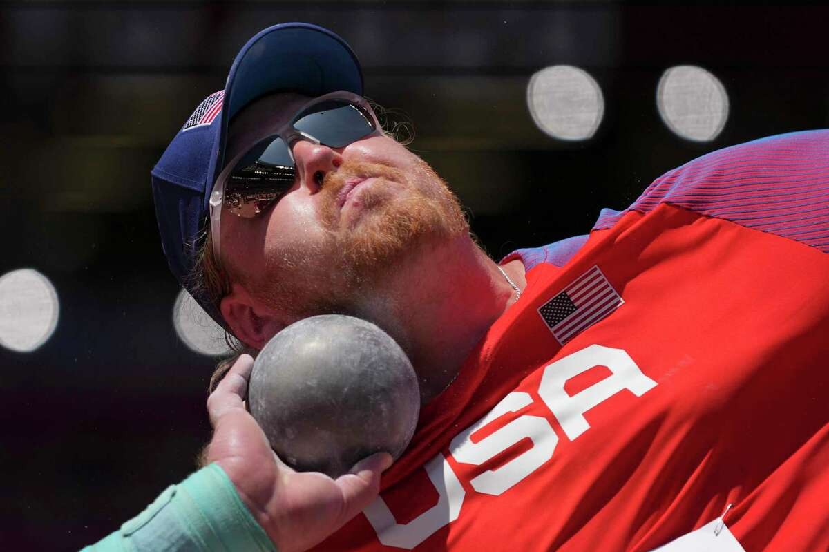 Ryan Crouser, of United States, competes in the final of the men's shot put at the 2020 Summer Olympics, Thursday, Aug. 5, 2021, in Tokyo. (AP Photo/Matthias Schrader)