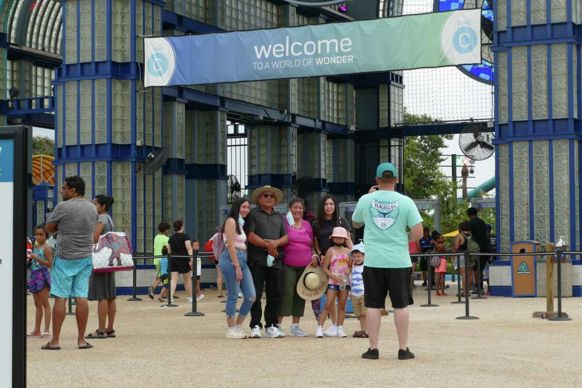 People arrive for an afternoon at SeaWorld San Antonio on Tuesday, Aug. 3, 2021.