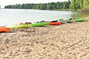 """Kayaks line the shore in Lincoln Park and await participants for the 2019 """"BiYaKathon."""" (Courtesy Photo)"""