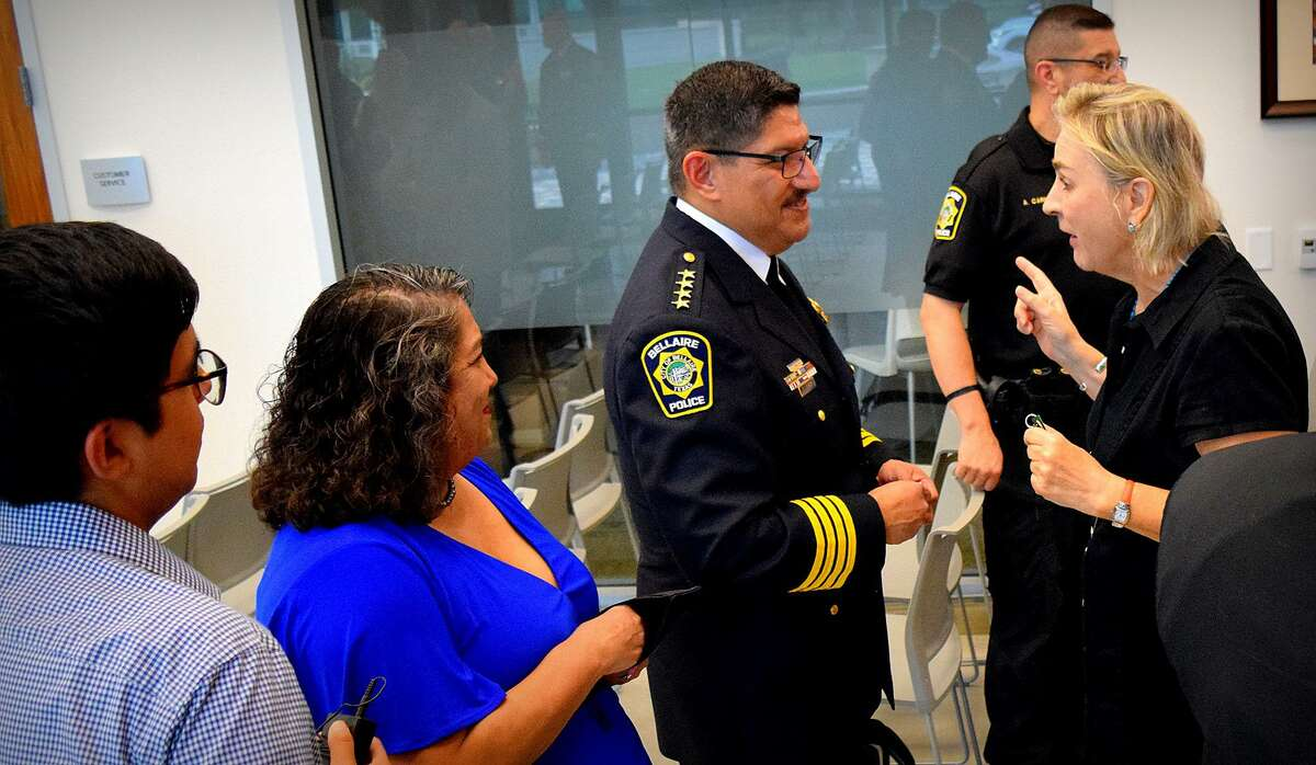 """Bellaire City Council member Catherine Lewis congratulates Onesimo """"Mo"""" Lopez Jr. following his being sworn in as the City of Bellaire's new Chief of Police at a ceremony on Aug. 2."""