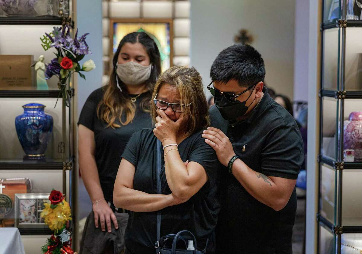 Bella Collins (left), Cassandra Quinto-Collins and Andrei Quinto mourn the loss of son and brother Angelo Quinto at Holy Cross Cemetery and Funeral Center in Antioch on June 23.