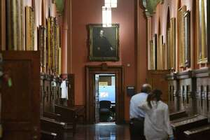 The Hall of Governors outside Gov. Andrew CuomoÕs executive offices is mostly quiet on Thursday, Aug. 5, 2021, at the Capitol in Albany N.Y. A report by Attorney General Letitia James found that Gov. Cuomo sexually harassed multiple women, violating state and federal law, and fostered a ÔtoxicÕ work environment.