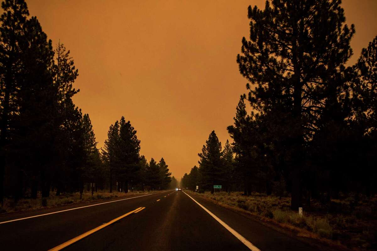 The sky is seen with an orange hue along Highway 44 during the Dixie Fire in Lassen County this week.