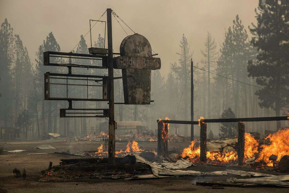 A structure is seen engulfed in flames along Interstate 36 during the Dixie Fire in Chester, California Wednesday, Aug. 4, 2021.