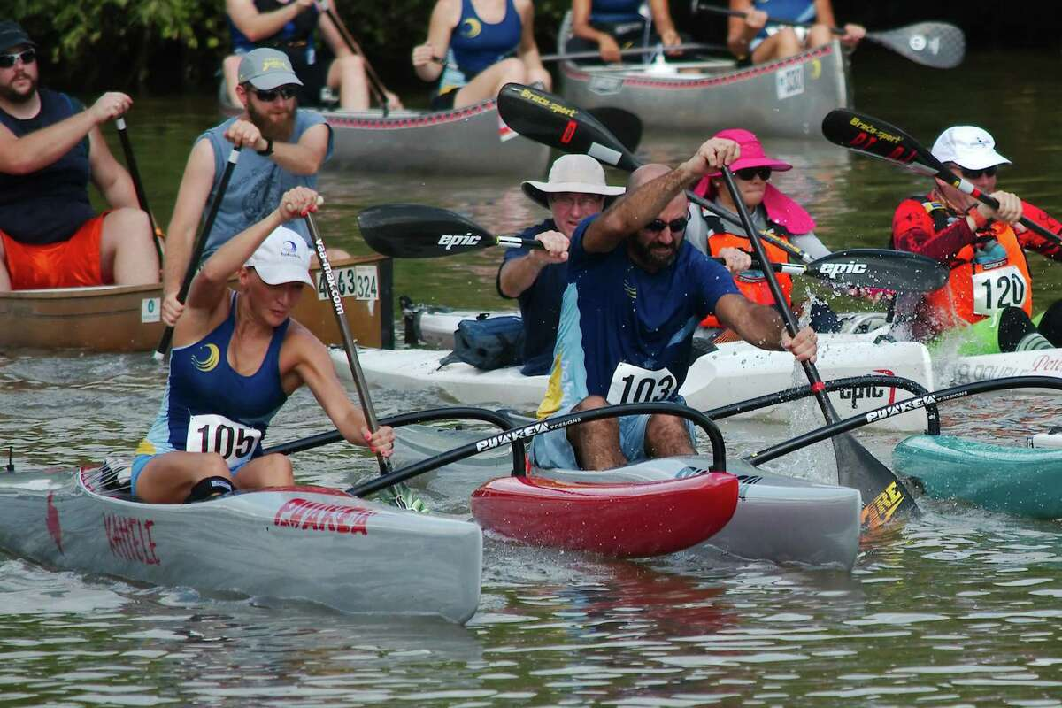 Participants paddle their canoes, kayaks and paddle boards down Clear Creek during the Clear Creek Paddle Race in 2019.