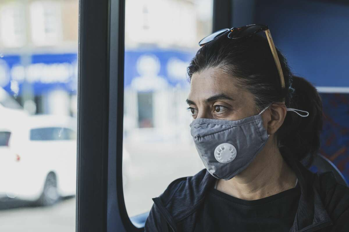 Woman wearing a protective face mask.