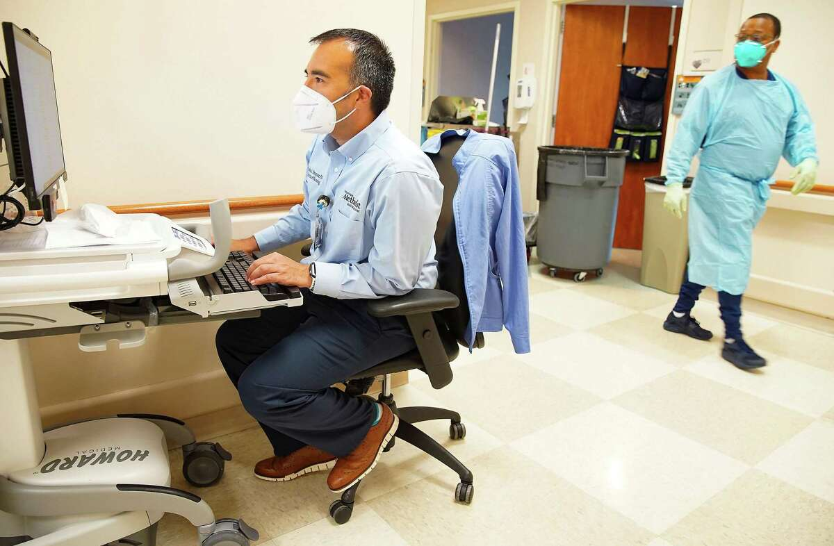 Pablo Vasquez, nurse manager at Houston Methodist, looks over all the request the hospital has received to transfer COVID patients to Houston Methodist Continuing Care Hospital in Katy on Tuesday, Aug. 3, 2021.