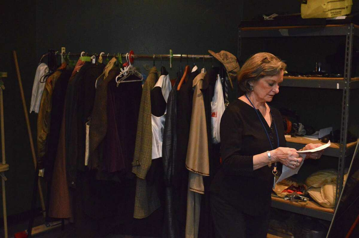 """Dresser Terry LeBel stands by some of the various costumes that she will help actors with at the performance of the show, """"Baskerville: A Sherlock Holmes Mystery"""" by The Town Players of New Canaan at the Powerhouse Theater in Waveny Park, in New Canaan, in a previous year. Another of the Town Players' show """"On Golden Pond"""" will launch the 75th Anniversary Season of the group at the theater, in Waveny Park in the town, on Friday, Aug. 13, and will run for three weekends."""